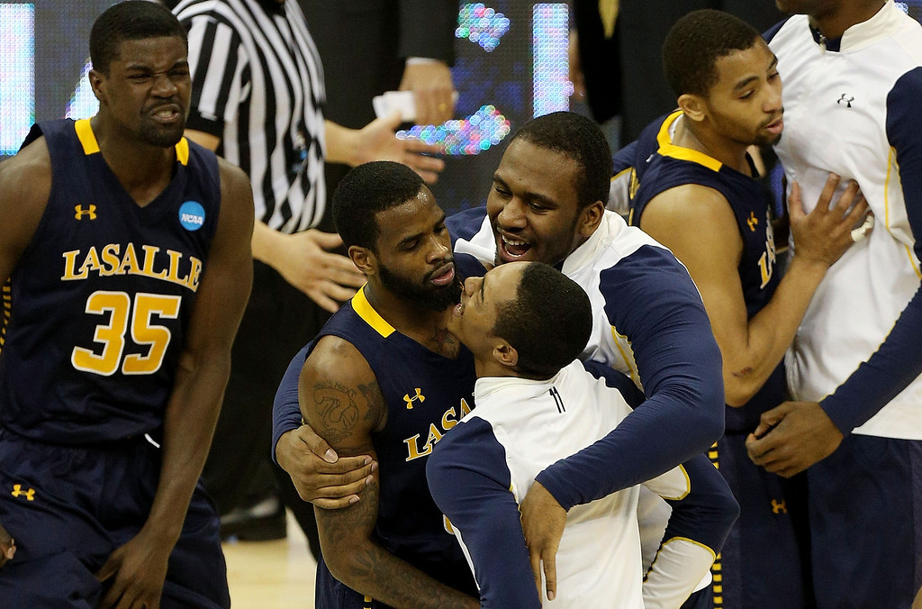 . KANSAS CITY, MO - MARCH 22:  The La Salle Explorers celebrate their 63-61 win over the Kansas State Wildcats during the second round of the 2013 NCAA Men\'s Basketball Tournament at the Sprint Center on March 22, 2013 in Kansas City, Missouri.  (Photo by Ed Zurga/Getty Images)