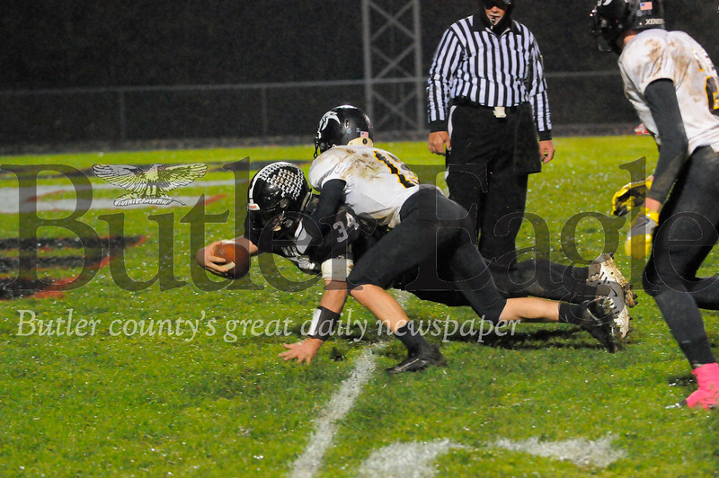 Moniteau #34 Cody Wise dives into the endzone as Keystone #13 Alex Rapp tackles him during a game at Moniteau Stdium on Friday October 26, 2018 (Jason Swanson photo)