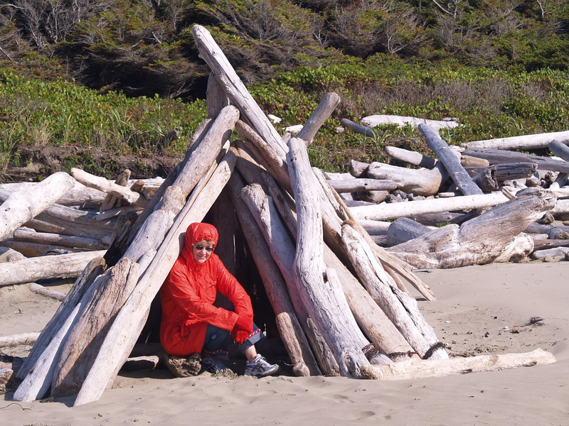 Linda amongst the driftwood.