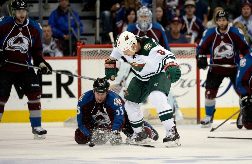 . DENVER, CO - APRIL 26: Colorado Avalanche left wing Cody McLeod (55) fights for the puck with Minnesota Wild center Cody McCormick (8)  during the third period of action. The Colorado Avalanche hosted the Minnesota Wild in the fifth round of the Stanley Cup Playoffs at the Pepsi Center in Denver, Colorado on Saturday, April 26, 2014. (Photo by John Leyba/The Denver Post)