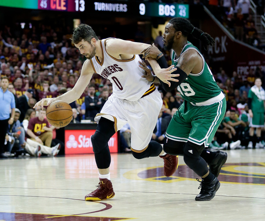 . Cleveland Cavaliers\' Kevin Love (0) drives on Boston Celtics\' Jae Crowder (99) during the second half of Game 3 of the NBA basketball Eastern Conference finals, Sunday, May 21, 2017, in Cleveland. The Celtics won 111-108. (AP Photo/Tony Dejak)