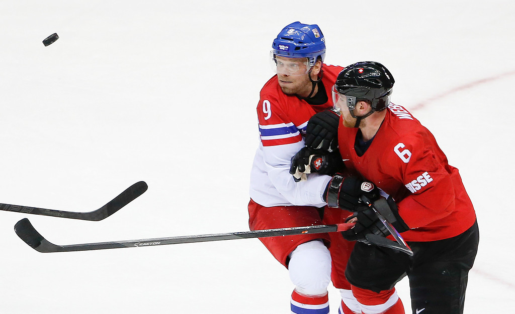 . Czech Republic forward Milan Michalek and Switzerland defenseman Yannick Weber vie for the puck at mid ice in the third period of a men\'s ice hockey game at the 2014 Winter Olympics, Saturday, Feb. 15, 2014, in Sochi, Russia. (AP Photo/Petr David Josek)