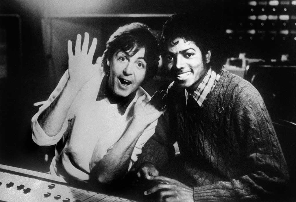 """. (FILES) Photo dated on December 19, 1983 shows British singer Paul McCartney and US pop star Michael Jackson (R). Michael Jackson died on June 25, 2009 after suffering a cardiac arrest, sending shockwaves sweeping across the world and tributes pouring for the tortured music icon revered as the \""""King of Pop.\"""" (AFP/Getty Images)"""