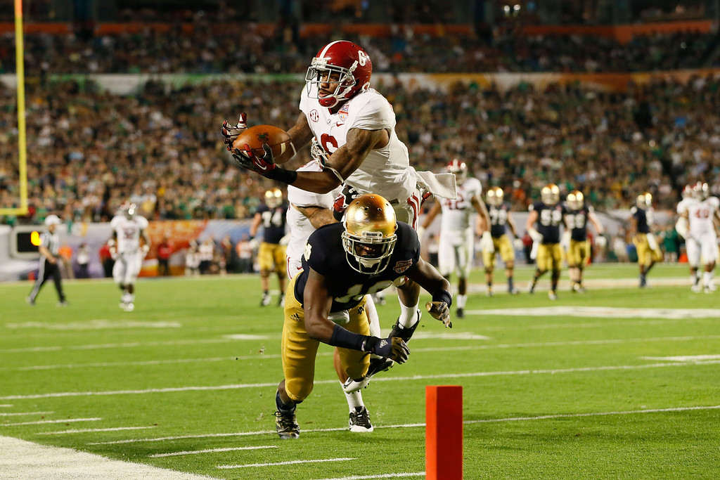 . MIAMI GARDENS, FL - JANUARY 07:  Blake Sims #6 of the Alabama Crimson Tide intercepts a pass intended for DaVaris Daniels #10 of the Notre Dame Fighting Irish in the third quarter of the 2013 Discover BCS National Championship game at Sun Life Stadium on January 7, 2013 in Miami Gardens, Florida.  (Photo by Kevin C. Cox/Getty Images)