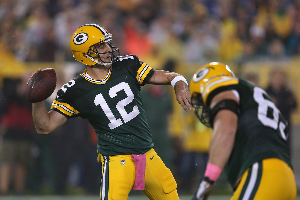 . GREEN BAY, WI - OCTOBER 02: Quarterback  Aaron Rodgers #12 of the Green Bay Packers looks to pass during the NFL game against the Minnesota Vikings at Lambeau Field on October 2, 2014 in Green Bay, Wisconsin. (Photo by Jonathan Daniel/Getty Images)