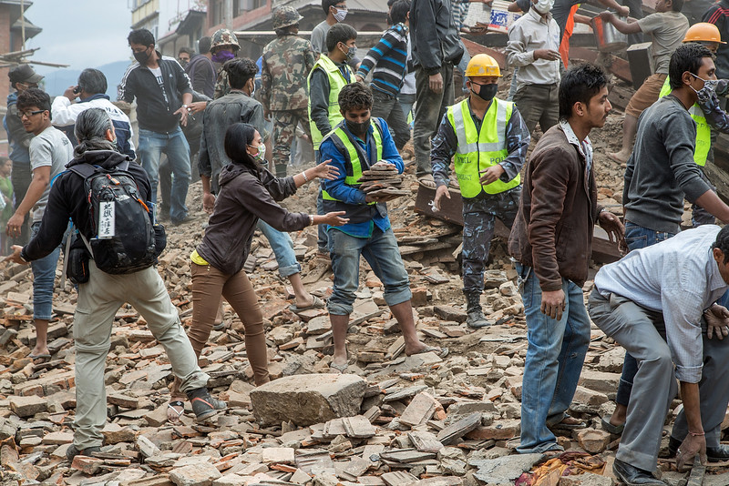 . Emergency workers and bystanders clear debris while searching for survivors under a collapsed temple in Basantapur Durbar Square following an earthquake on April 25, 2015 in Kathmandu, Nepal. A major 7.8 earthquake hit Kathmandu mid-day on Saturday, and was followed by multiple aftershocks that triggered avalanches on Mt. Everest that buried mountain climbers in their base camps. Many houses, buildings and temples in the capital were destroyed during the earthquake, leaving hundreds dead or trapped under the debris as emergency rescue workers attempt to clear debris and find survivors.  (Photo by Omar Havana/Getty Images)