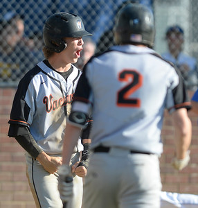 Vacaville High clinches tie for MEL baseball crown, downs Wood in extras