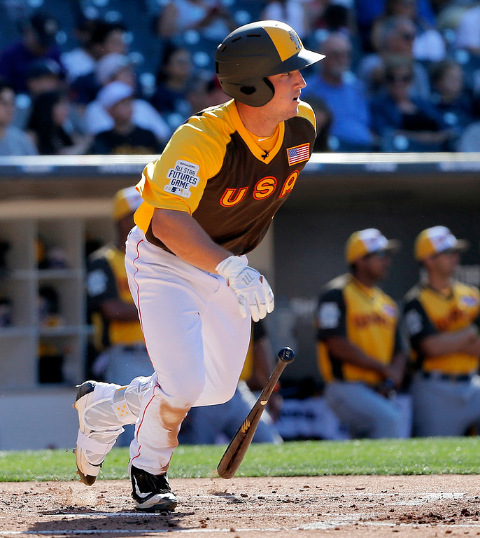 . U.S. Team\'s Alex Bregman, of the Houston Astros, connects for a base hit against the World Team during the third inning of the All-Star Futures baseball game, Sunday, July 10, 2016, in San Diego. (AP Photo/Lenny Ignelzi)