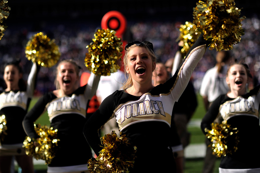 . Monarch cheerleader fire up the crowd during the 4A State Championships game against Denver South.    Hyoung Chang, The Denver Post