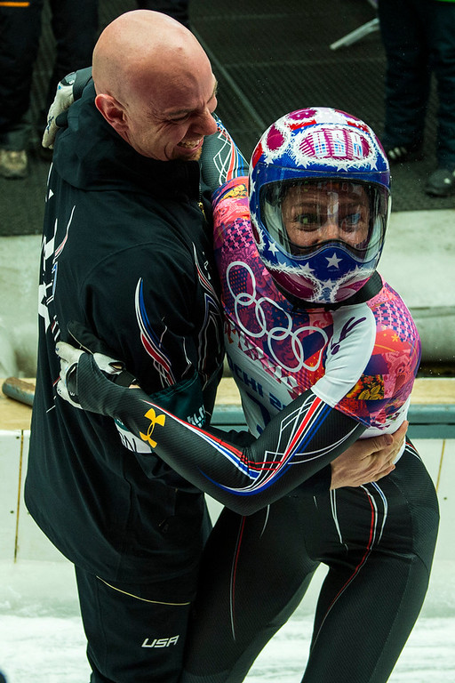 . Noelle Pikus-Pace celebrates with her coach Tuffy Latour after winning the silver medal in the women\'s skeleton competition at Sanki Sliding Center during the 2014 Sochi Olympics Friday February 14, 2014. Pikus-Pace finished with a time of 3:53.86. (Photo by Chris Detrick/The Salt Lake Tribune)