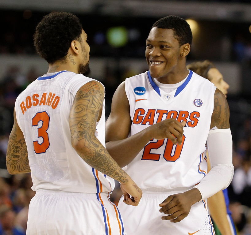 . Florida\'s Mike Rosario (3) and Michael Frazier II (20) react during the second half of a regional semifinal game against Florida Gulf Coast in the NCAA college basketball tournament, Saturday, March 30, 2013, in Arlington, Texas. (AP Photo/David J. Phillip)