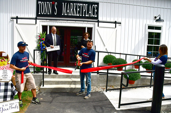 9/5/2019 Mike Orazzi | StaffrJordan Tonn cuts the ribbon officially opening Tonns Marketplace on the Bristol Burlington line on Thursday afternoon.