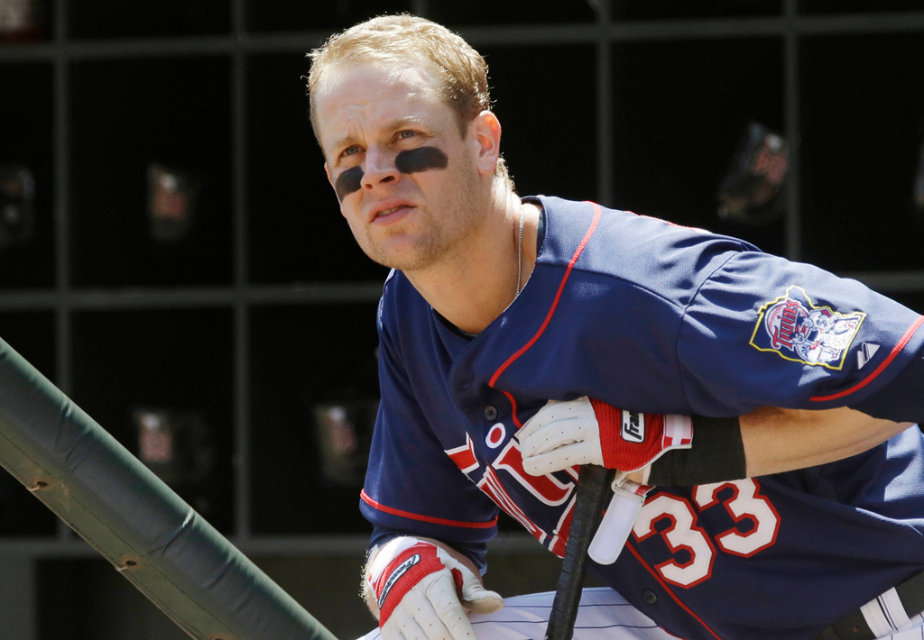. Minnesota\'s Justin Morneau, the subject of recent trade rumors, waits his turn to bat in the first inning against the Indians. (AP Photo/Jim Mone)