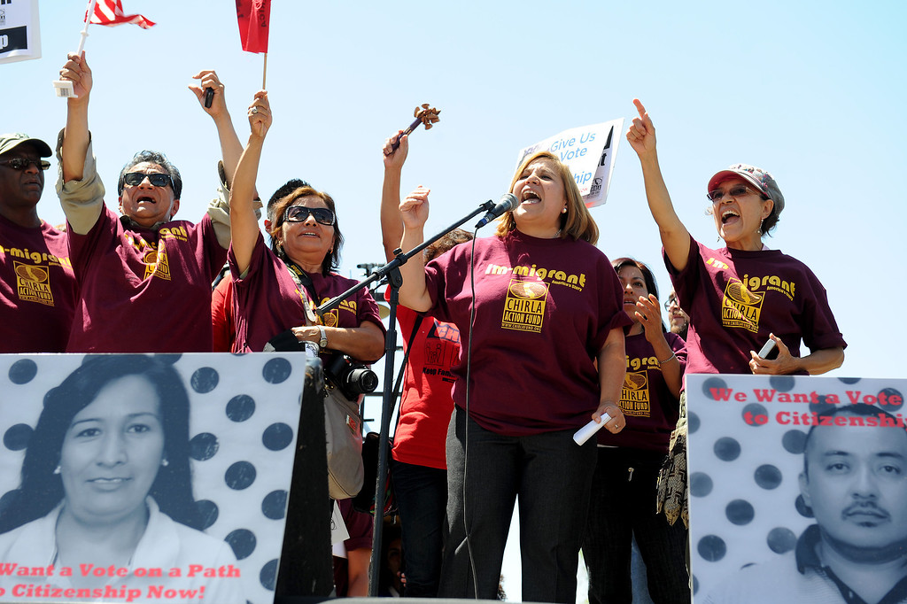 ". Angelica Salas, second from right, executive director of CHIRLA, speaks at the ""Caravan for Citizenship\"" rally at Yokuts Park in Bakersfield, Wednesday, August 14, 2013. (Michael Owen Baker/L.A. Daily News)"