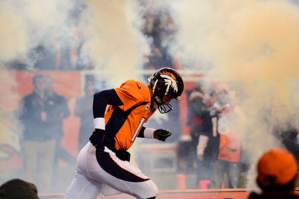 . DENVER, CO - DECEMBER 12: Denver Broncos quarterback Peyton Manning (18) running out on the died at the start of the game. The Denver Broncos vs. the San Diego Chargers at Sports Authority Field at Mile High in Denver on December 12, 2013. (Photo by AAron Ontiveroz/The Denver Post)