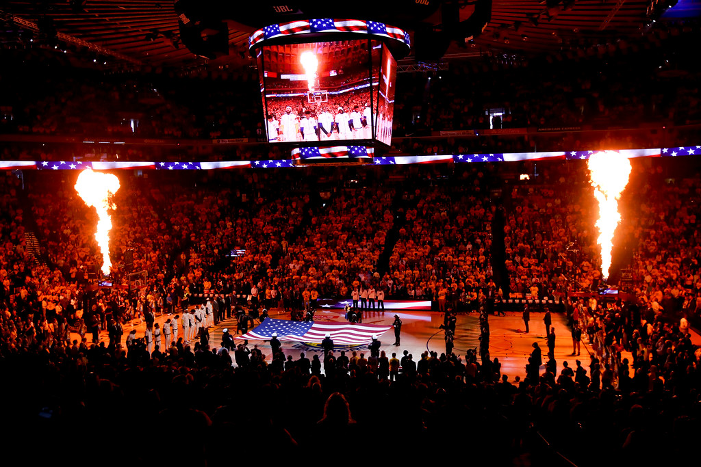 . Fans watch from a general view of Oracle Arena as the flag is presented before Game 1 of basketball\'s NBA Finals between the Golden State Warriors and the Cleveland Cavaliers in Oakland, Calif., Thursday, May 31, 2018. (AP Photo/Ben Margot)