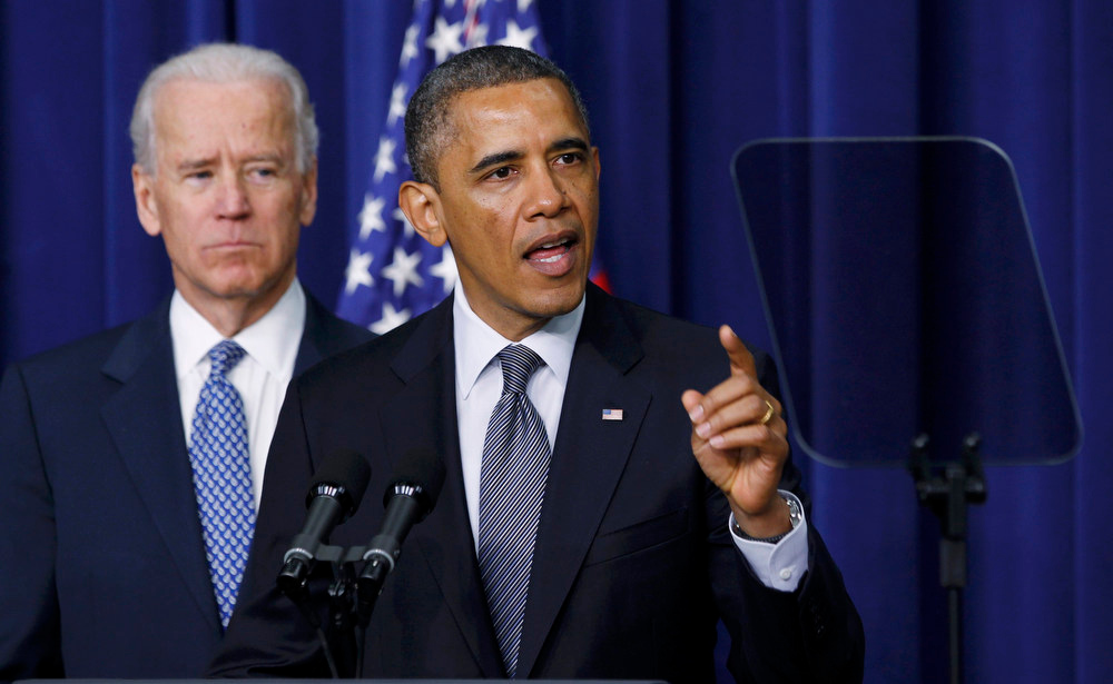 . U.S. President Barack Obama (R) and Vice President Joe Biden announce a series of proposals to counter gun violence during an event at the White House in Washington January 16, 2013. Biden delivered his recommendations to Obama after holding a series of meetings with representatives from the weapons and entertainment industries as requested by the president after the December 14 school shooting in Newtown, Connecticut, in which 20 children and six adults were killed.     REUTERS/Kevin Lamarque