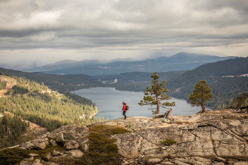 Hiker on Donner Summit overlooking Donner Lake