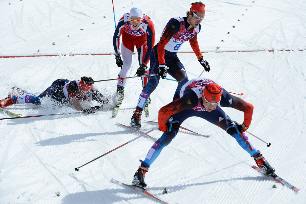 . Gold medalist Russia\'s Alexander Legkov (3 Front) silver medalist Russia\'s Maxim Vylegzhanin (ground) bronze medalist Russia\'s Ilia Chernousov and Norway\'s Martin Johnsrud Sundby (1) cross the finish line in the Men\'s Cross-Country Skiing 50km Mass Start Free at the Laura Cross-Country Ski and Biathlon Center during the Sochi Winter Olympics on February 23, 2014, in Rosa Khutor, near Sochi.  AFP PHOTO / KIRILL KUDRYAVTSEVKIRILL KUDRYAVTSEV/AFP/Getty Images