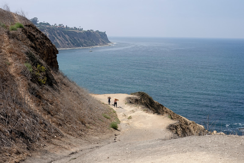 Two surfers end their morning at Bluff Cove in Palos Verdes Estates