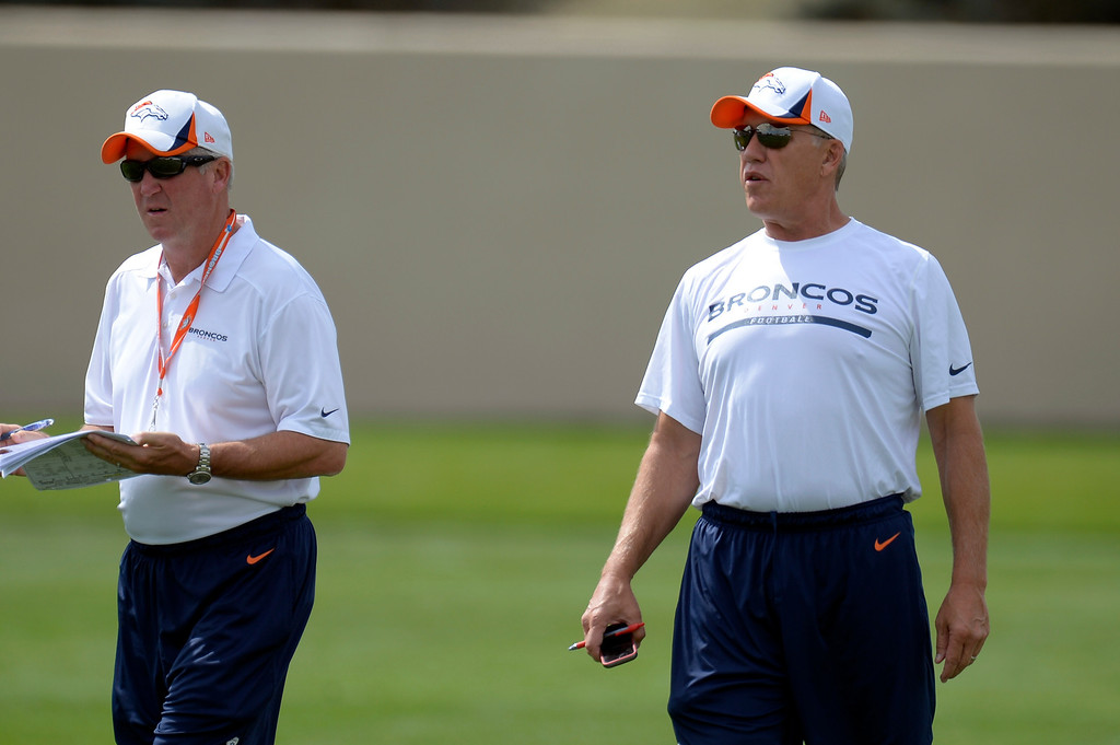 . Denver Broncos head coach John Fox (L) and Executive VP of Football Operations John Elway look on during practice August 23, 2013 at Dove Valley (Photo by John Leyba/The Denver Post)