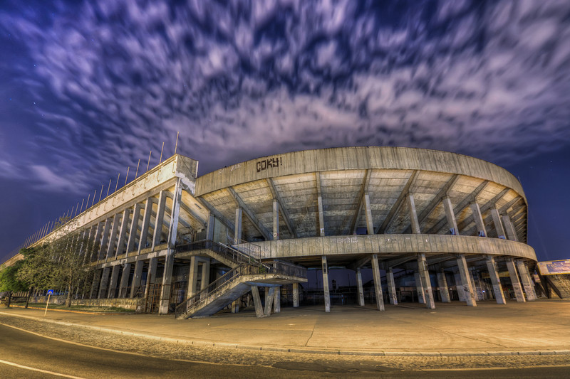 Modern Colosseum  This stadium is big, really big :). This is the Strahov stadium in Prague. I really would like to see how they did the COKY! graffiti on it, as it's quite hight :)  HDR from three shots, taken with Canon 450D with Sigma 10-20mm lens, from a tripod.
