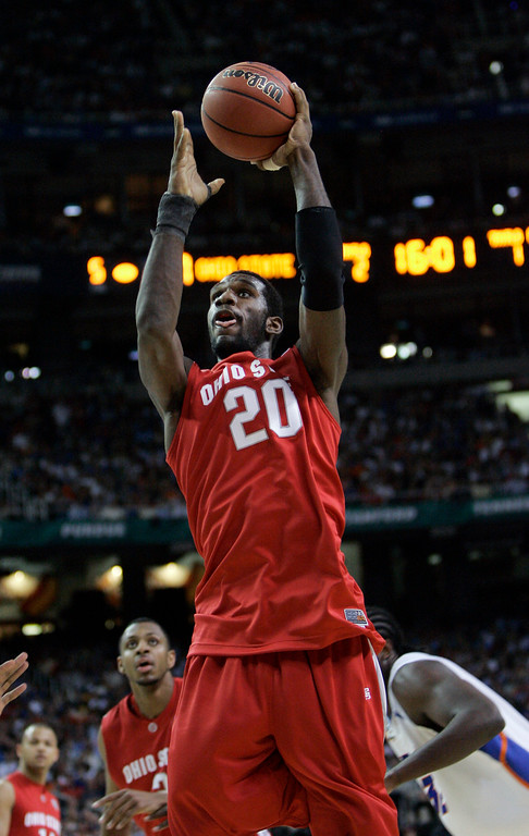 . Ohio State center Greg Oden (20) shoots in the first half during their men\'s championship basketball game against Florida at the Final Four in the Georgia Dome in Atlanta Monday, April 2, 2007. (AP Photo/Gerry Broome)