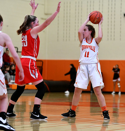 12/26/2019 Mike Orazzi | StaffrTerryville High School's Kassandra McCarthy (11) and Northwestern's Jana Sanden (23) during Thursday's girls basketball game in Terryville. r
