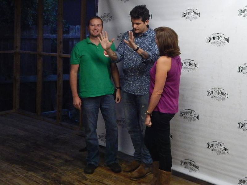 Director of Communications Chris Johnson (left) and wife Shellie Johnson met with Grammy-winner John Mayer before his Sept. 27, 2013, concert in Atlanta to thank him for his volunteer efforts at The Fuller Center's 2013 Veterans Build in Shreveport.
