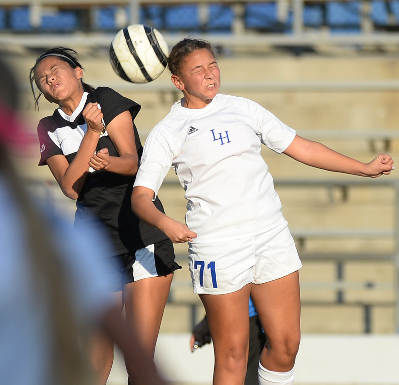 . La Habra\'s Samiya Washington (#71) leaps for a headshot as they play Sunny Hills in their girls soccer game at La Habra High School on Thursday January 16, 2014. Sunny Hills defeated La Habra 2-0. (Staff Photo by Keith Durflinger/San Gabriel Valley Tribune)