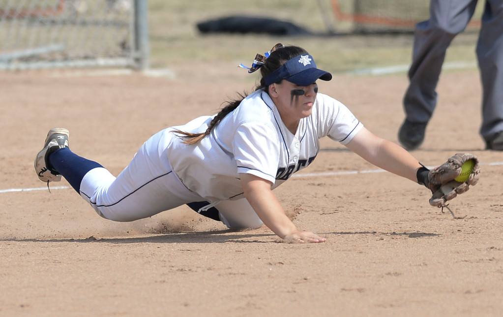 . North third baseman Tessa Tomaselli (5) makes a diving stop on a Peninsula hit in a first round CIF SS Division III softball game Thursday in Torrance. Peninsula won 4-1. 20130516 Photo by Steve McCrank / Staff Photographer