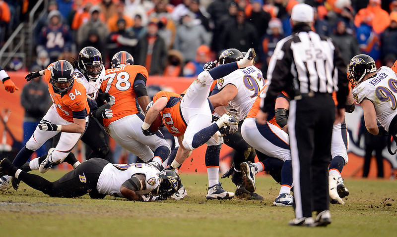 . Denver Broncos running back Jacob Hester (40) gets up-ended during the first half.  The Denver Broncos vs Baltimore Ravens AFC Divisional playoff game at Sports Authority Field Saturday January 12, 2013. (Photo by John Leyba,/The Denver Post)