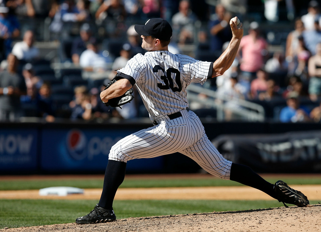 . New York Yankees relief pitcher David Robertson (30) delivers a ninth-inning pitch in a baseball game against the Detroit Tigers at Yankee Stadium in New York, Thursday, Aug. 7, 2014.  Robertson earned the save as the Yankees defeated the Tigers 1-0. (AP Photo/Kathy Willens)