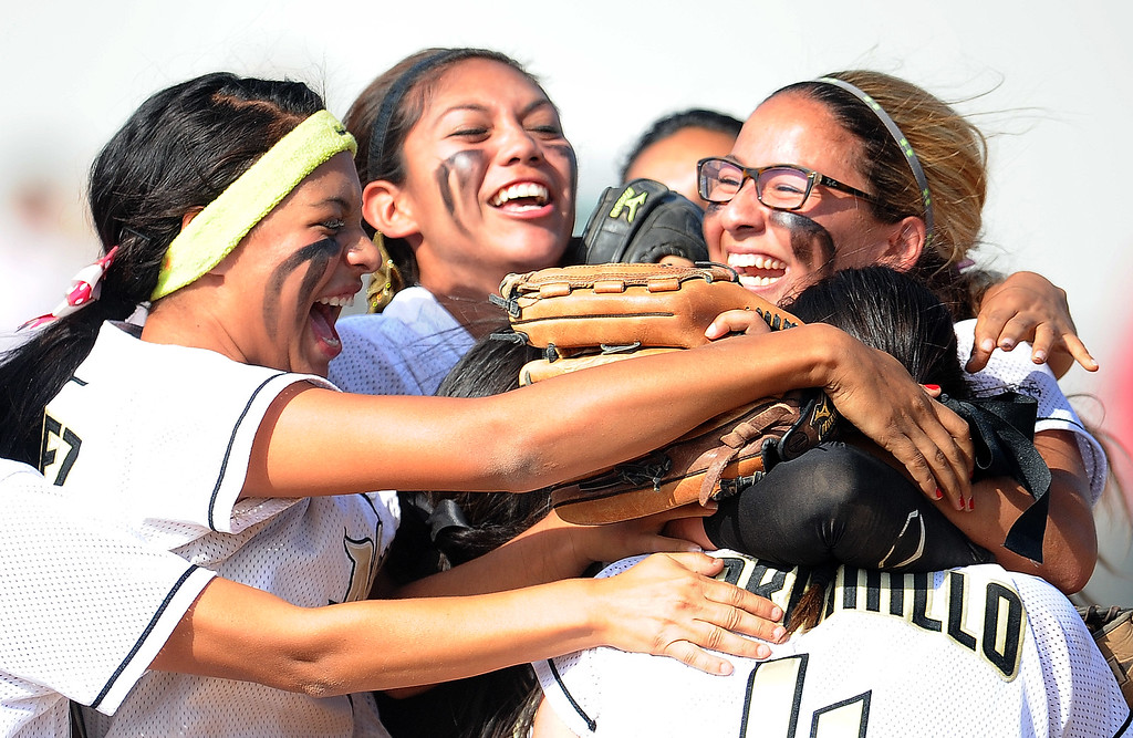 . Northview\'s Jocelyn Marquez (headband) celebrates with teammates after defeating Barstow 5-4 during a CIF-SS quarterfinal playoff softball game at Northview High School on Thursday, May 23, 2013 in Covina, Calif. Marquez hit a solo home run in the sixth inning to break the tie.  (Keith Birmingham Pasadena Star-News)