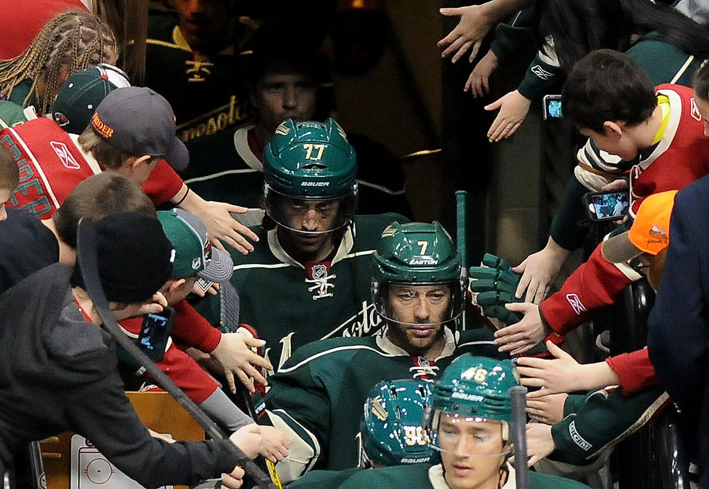 . Fans reach out to Wild players as  they take to the ice. (Pioneer Press: Sherri LaRose-Chiglo)
