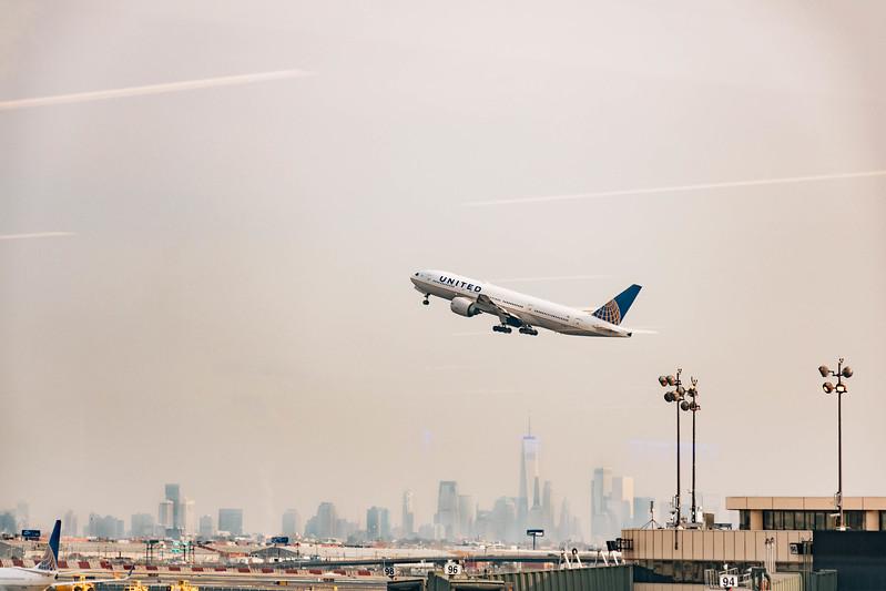 United airplane flying with skyline_.jpg