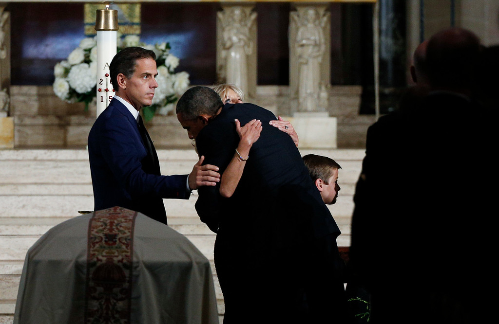 . President Barack Obama hugs Jill Biden during funeral services for Vice President Joe Biden\'s son, former Delaware Attorney General Beau Biden, Saturday, June 6, 2015, at St. Anthony of Padua Church in Wilmington, Del. (Kevin Lamarque/Pool Photo via AP)