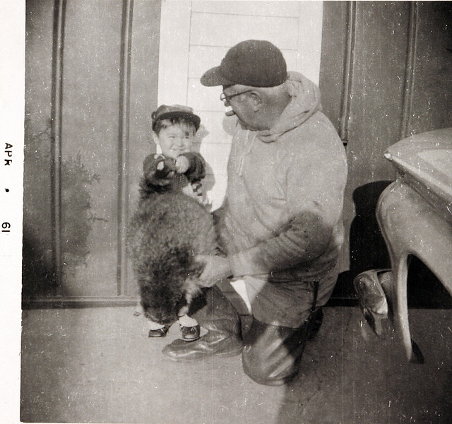 Dad and Norm holding a Raccoon.JPG
