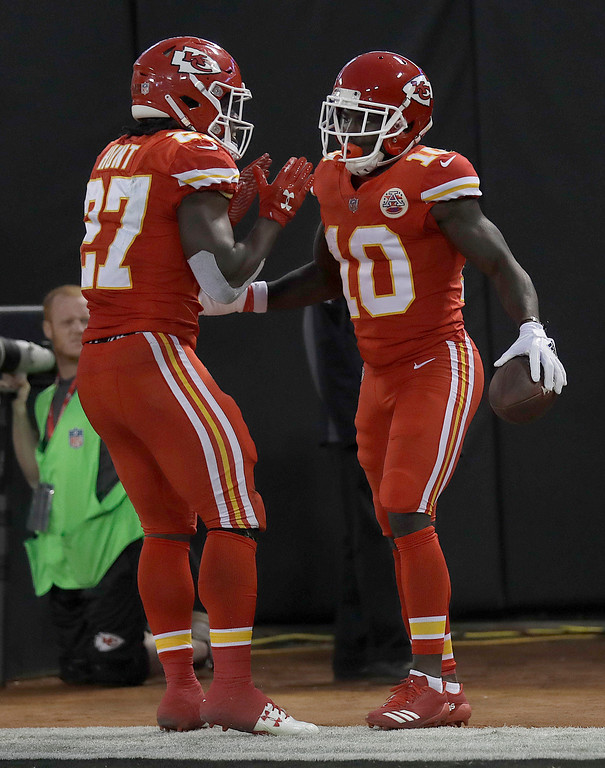 . Kansas City Chiefs wide receiver Tyreek Hill (10) is congratulated by running back Kareem Hunt (27) after scoring a touchdown against the Oakland Raiders during the first half of an NFL football game in Oakland, Calif., Thursday, Oct. 19, 2017. (AP Photo/Marcio Jose Sanchez)