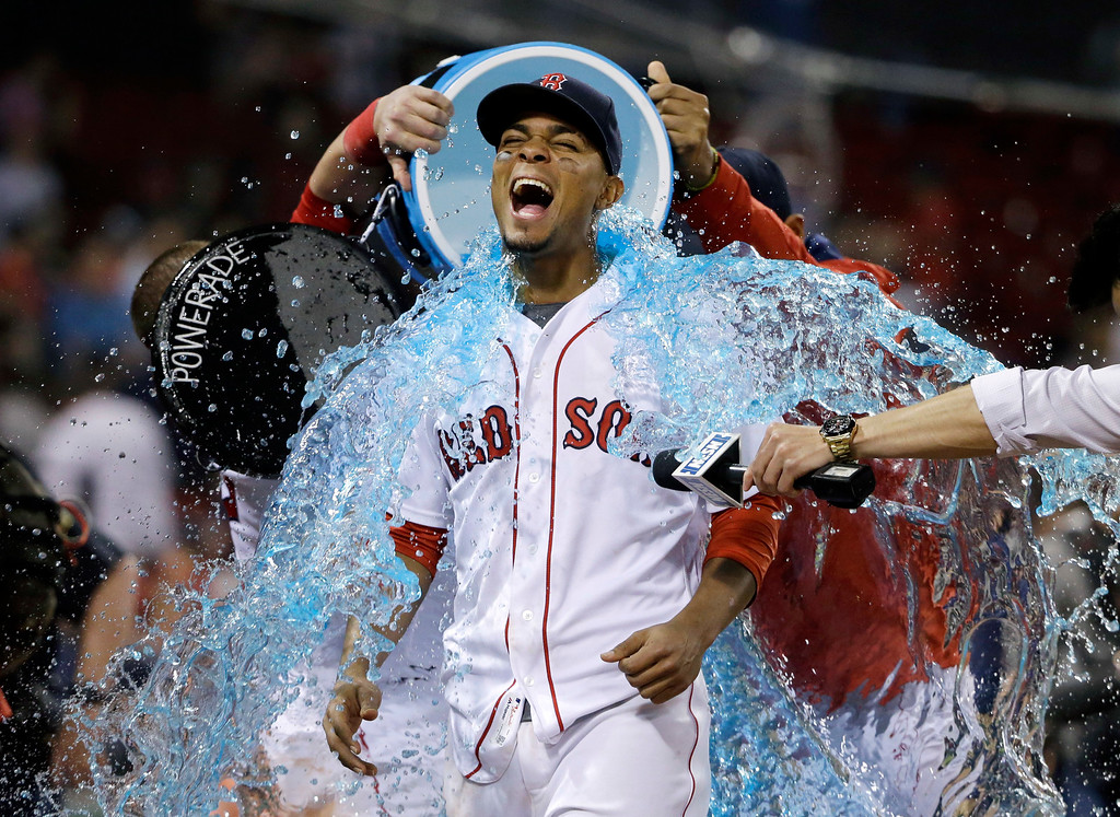. Boston Red Sox\'s Mookie Betts is doused after the Red Sox defeated the Houston Astros 11-1 in a baseball game Thursday, May 12, 2016, in Boston. Betts hit a three-run home run. (AP Photo/Elise Amendola)