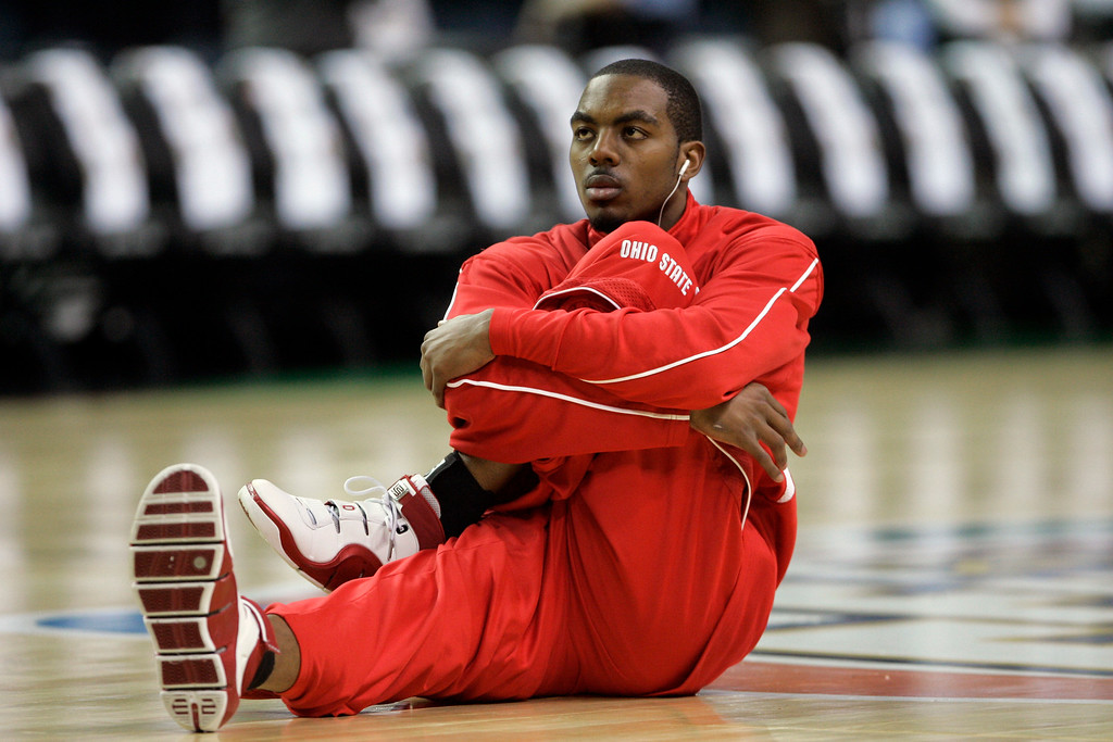 . Ohio State guard Ron Lewis (12) stretches on the court before the start of the Final Four basketball championship game at the Georgia Dome in Atlanta, Monday, April 2, 2007. Ohio State will face Florida in the championship match game.  (AP Photo/Mark Humphrey)