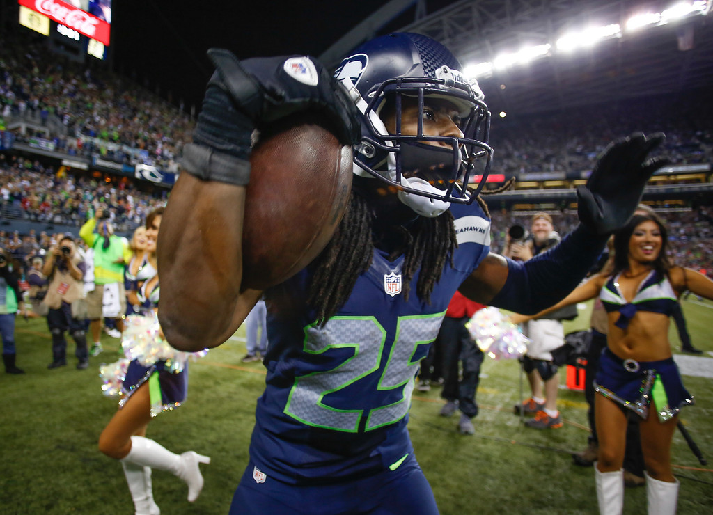. Cornerback Richard Sherman #25 of the Seattle Seahawks celebrates after making an interception in the second half against the San Francisco 49ers at CenturyLink Field on September 15, 2013 in Seattle, Washington.  (Photo by Otto Greule Jr/Getty Images)