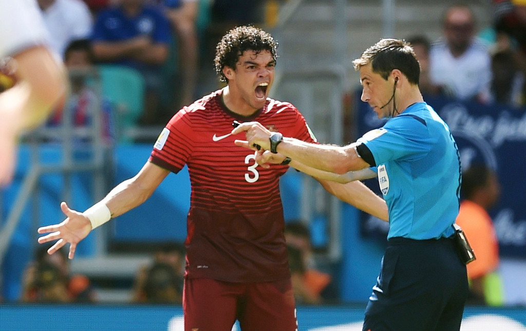 . Portugal\'s Pepe (3) argues with referee Milorad Mazic from Serbia during the group G World Cup soccer match between Germany and Portugal at the Arena Fonte Nova in Salvador, Brazil, Monday, June 16, 2014.  (AP Photo/Paulo Duarte)