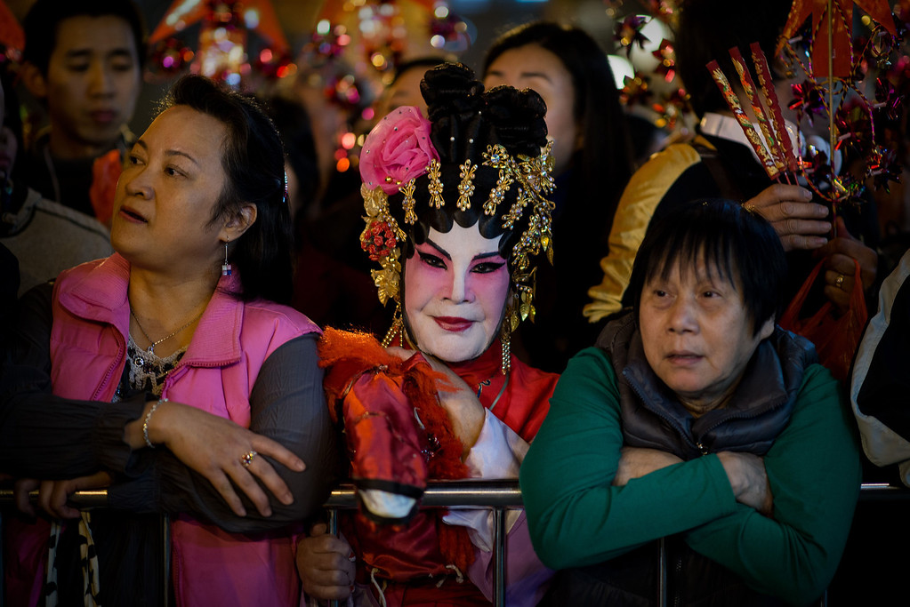 . Worshippers wait to burn incense and pray at the Wong Tai Sin Temple to welcome the Chinese New Year of the horse in Hong Kong on January 30, 2014. Tens of thousands of worshippers flocked to temples across to pray for good luck and fortune for the new year.  AFP PHOTO / Philippe LOPEZ/AFP/Getty Images