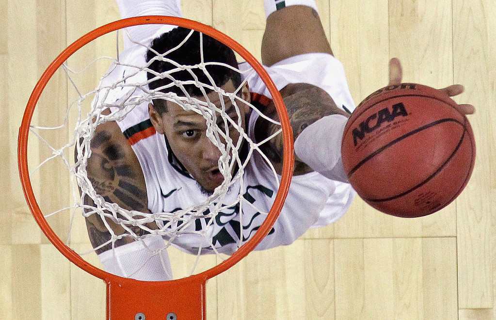 . Miami\'s Rion Brown goes up for a shot during the first half of a second-round game of the NCAA college basketball tournament against the Pacific Friday, March 22, 2013, in Austin, Texas.  (AP Photo/David J. Phillip)