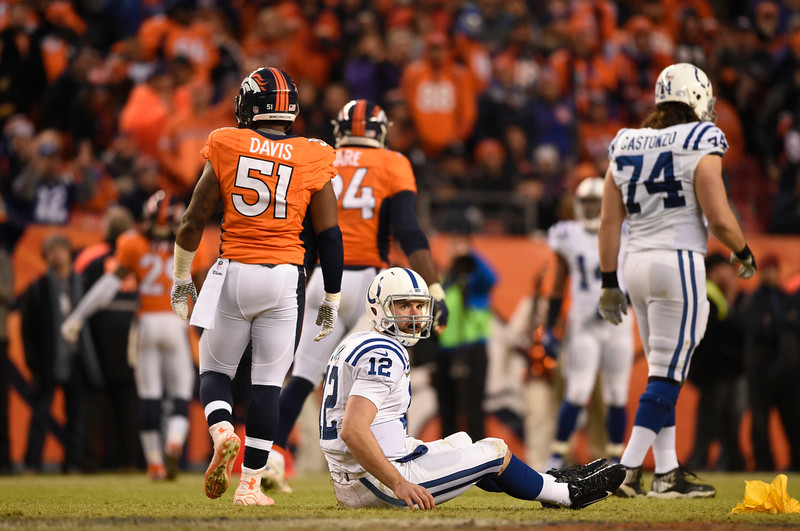 . Andrew Luck (12) of the Indianapolis Colts gets knocked down in the third quarter. The Denver Broncos played the Indianapolis Colts in an AFC divisional playoff game at Sports Authority Field at Mile High in Denver on January 11, 2015. (Photo by AAron Ontiveroz/The Denver Post)