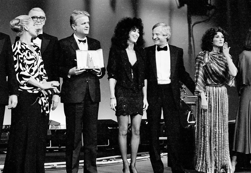 . Italian actress Virna Lisi, left,  presents part of the best awards of the 38th Cannes film festival Monday night, May 20, 1985. From left to right are: U.S. actor James Stewart, Yugoslav production Mirza Pasic, U.S. actress Cher, U.S. film director John Boorman and Argentine actress Norma Aleandro. (AP Photo/Michel Lipchitz)