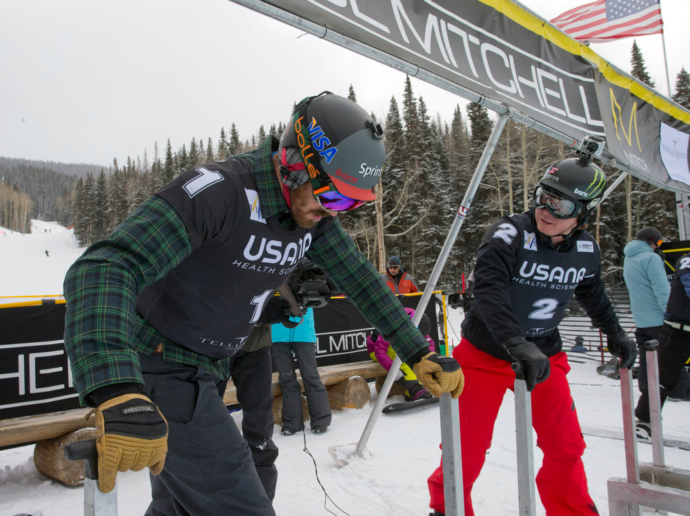 . In this image provided by Nathan Bilow Photography, United States teammates Seth Wescott, left, and Nate Holland get into the starting gate before the snowboard cross team World Cup event in Telluride, Colo., Saturday, Dec. 15, 2012. Wescott and Holland took home the first-place win. (AP Photo/Nathan Bilow)