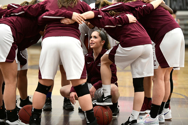 2/8/2019 Mike Orazzi | Staff Bristol Central's Erika Santilli (14) in the huddle before the start of Friday night's girls basketball game with Innovation.