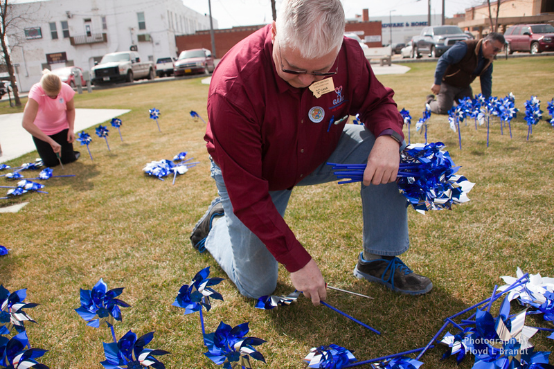Havre Daily News/Floyd BrandtCASA memberSteve Snell met in Town Square to plant pinwheels Thursday. Each pinwheel represents a child that CASA has intervended for. There are 211 pinwheels planted in the square. Executive Director Mark Douglas said that he was glad that the number not any higher.